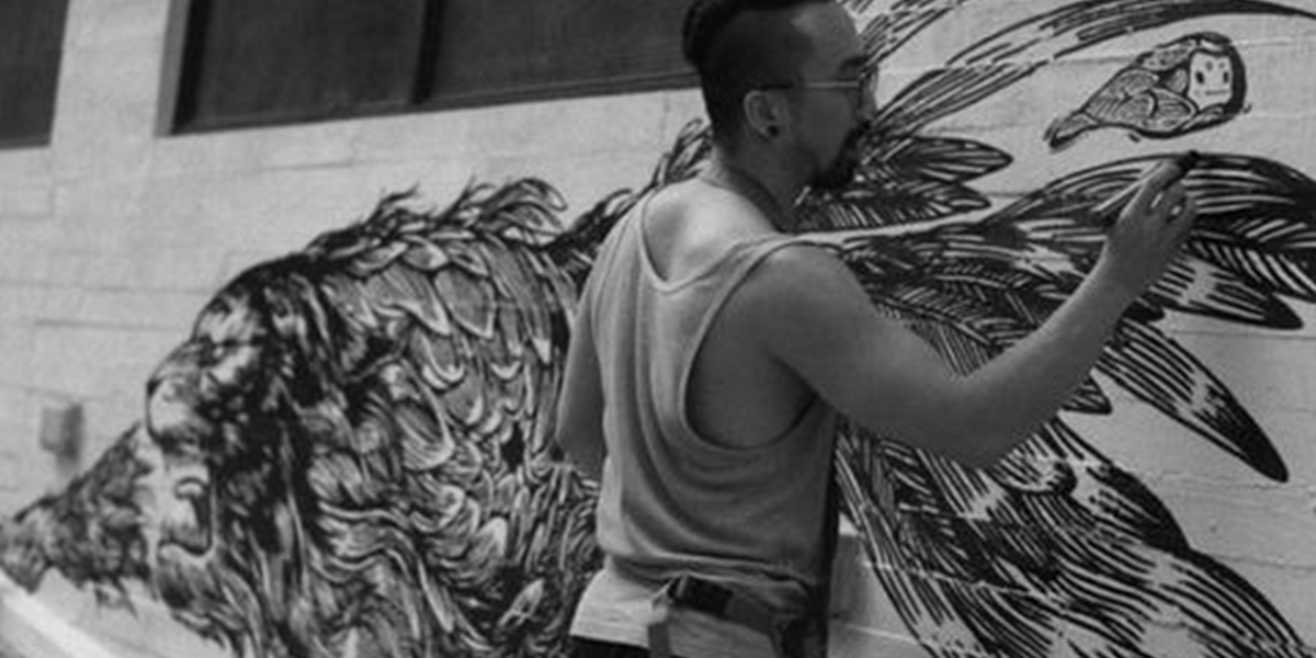 Picture of Artist using Air Ink to create a mural painting