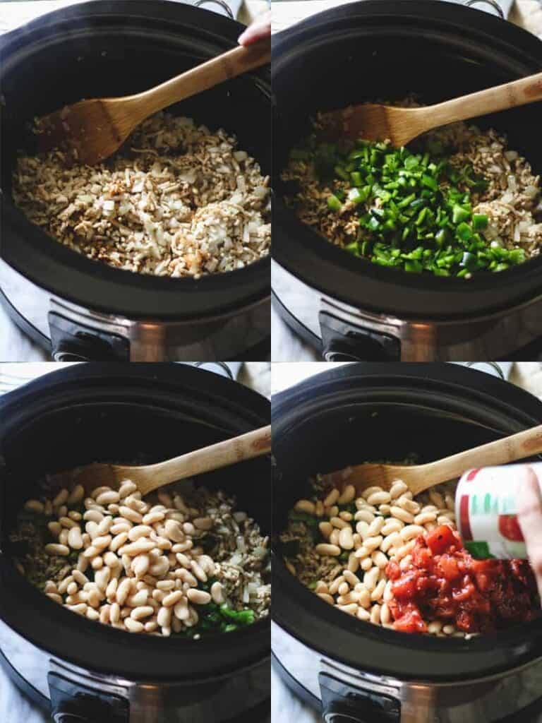 Black slow-cooker with ground chicken, peppers, cannellini beans and tomatoes
