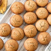 gluten free whole grain banana muffins on a wire rack