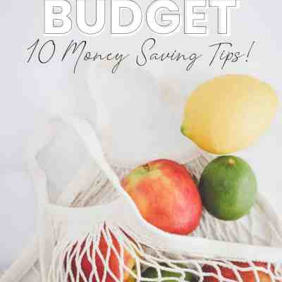 gluten free on a budget, 10 money saving tips, mesh reusable shopping bag with apples, lemons, and limes spilling out.