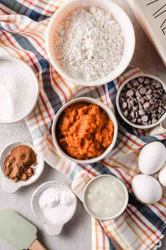 Ingredients for gluten free pumpkin bread measured in bowls.