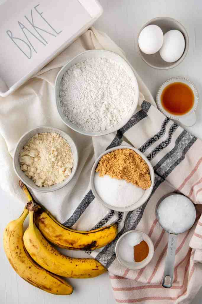 Ingredients for banana bread measured out in bowls.