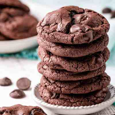 A stack of gluten-free double chocolate chip cookies.