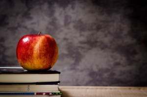 Photo: Apple and school books