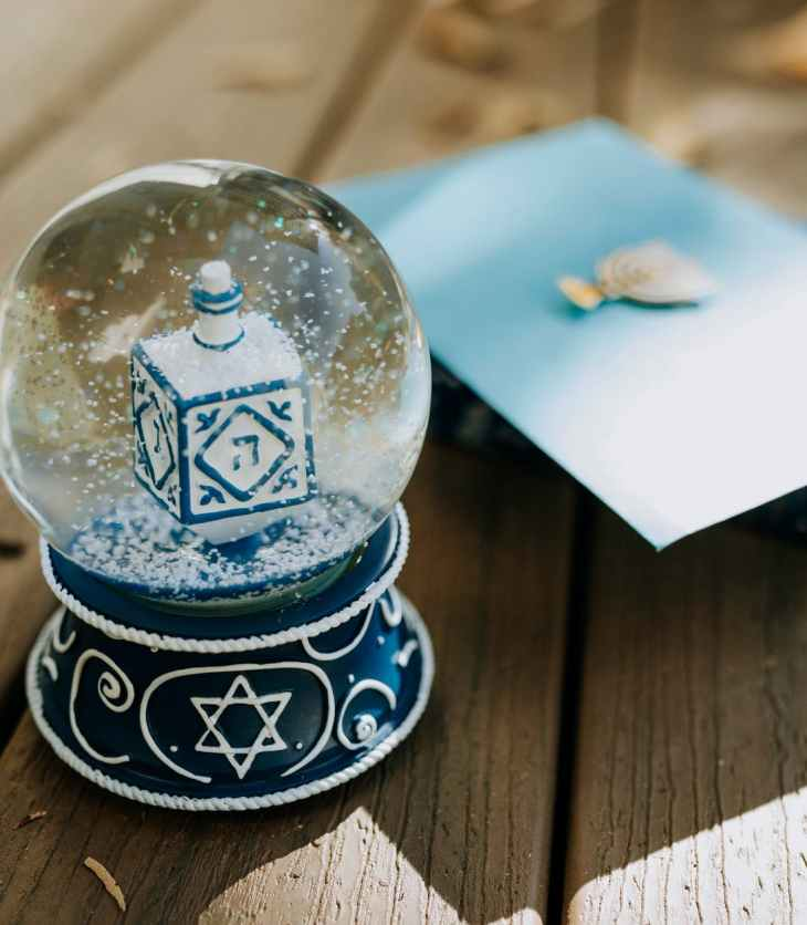 close up photo of a snow globe on wooden surface