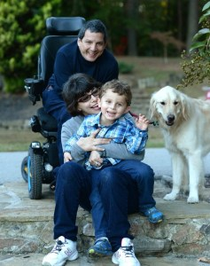 Dad in Wheelchair and family.