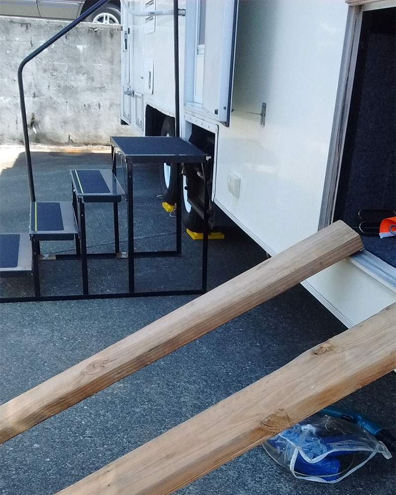 PHOTO DESCRIPTION: Makeshift ramp created with two boards.