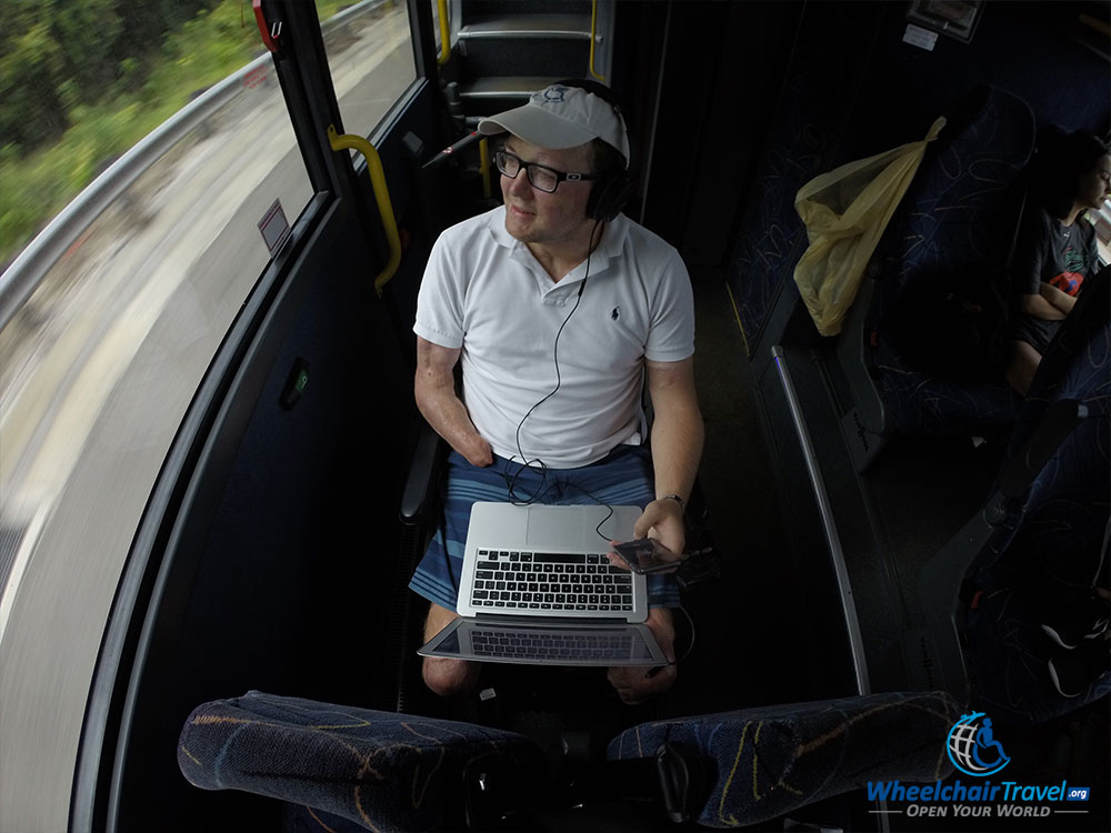 Wheelchair user seated in personal wheelchair on Megabus bus.