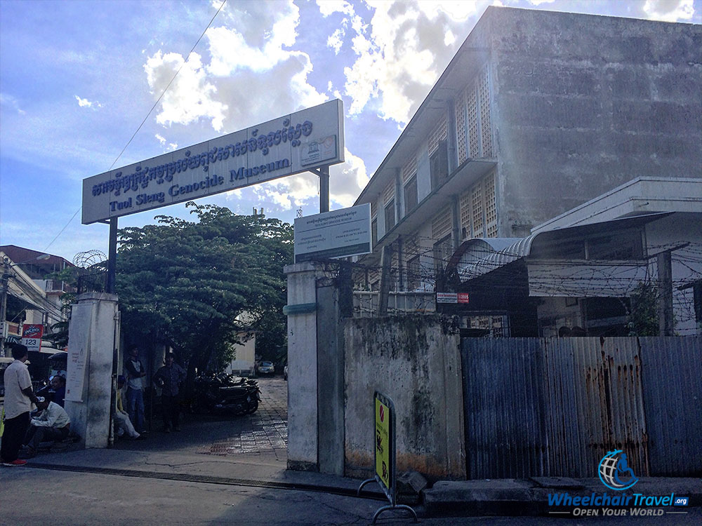 facing history at s n genocide museum photo description walled property a gate on a street corner opened to the