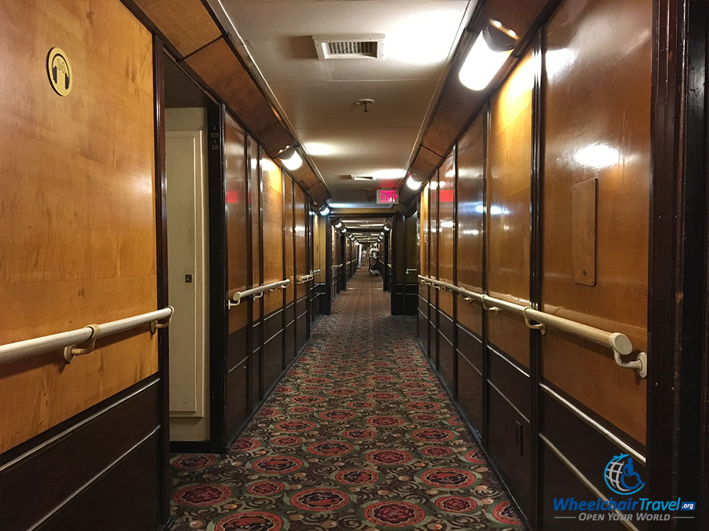 PHOTO: A-Deck passageway onboard the RMS Queen Mary, with passenger cabins located down the hall.