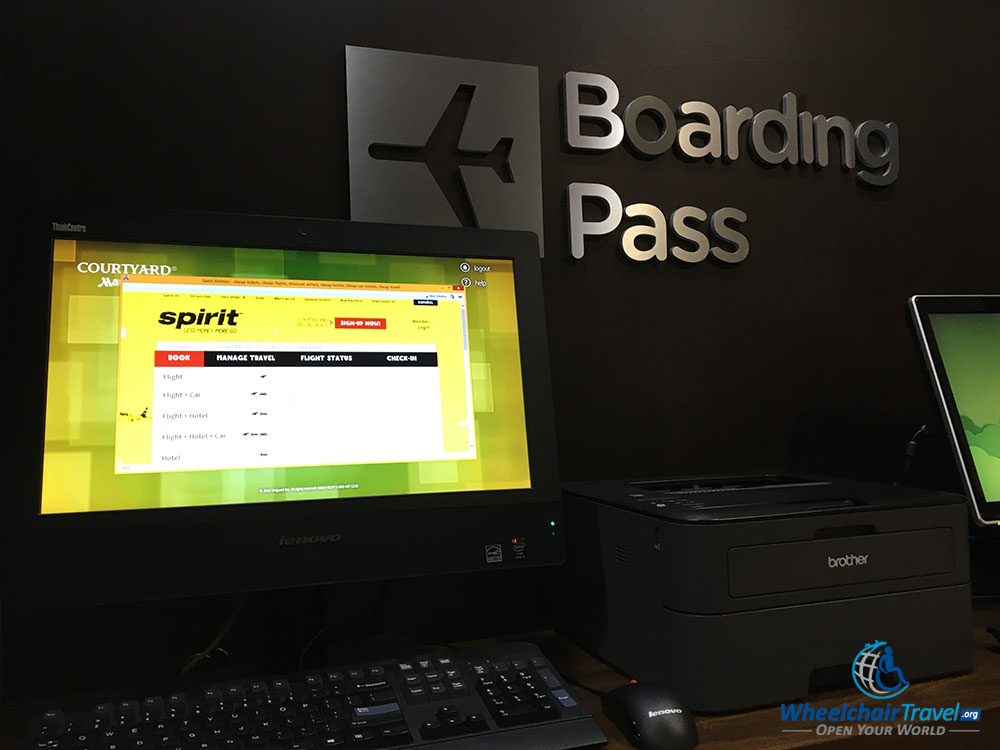 PHOTO: Printing Spirit Airlines boarding pass at hotel computer.