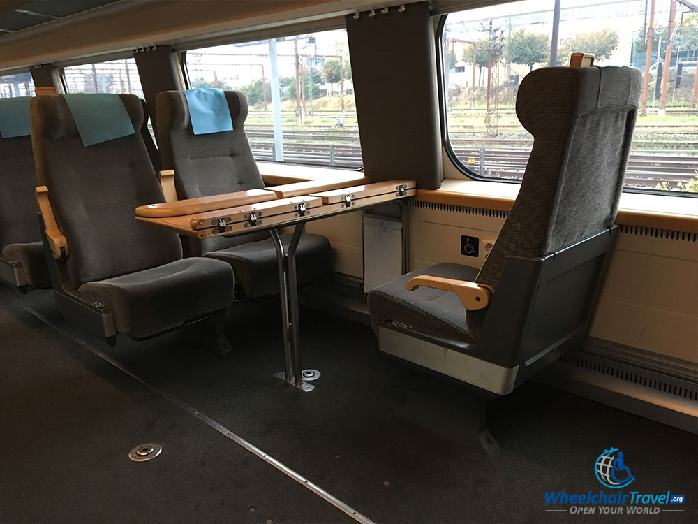 Wheelchair securement space next to seat on SJ train.