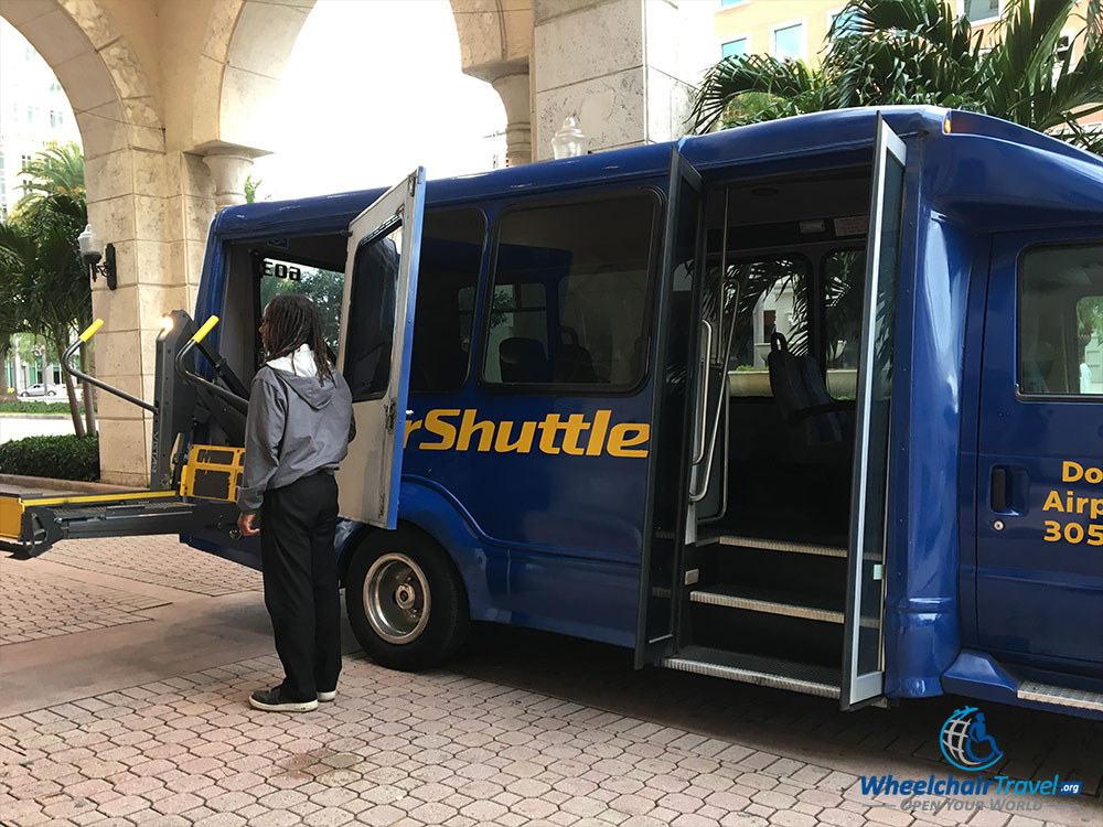 SuperShuttle minibus with wheelchair lift extended
