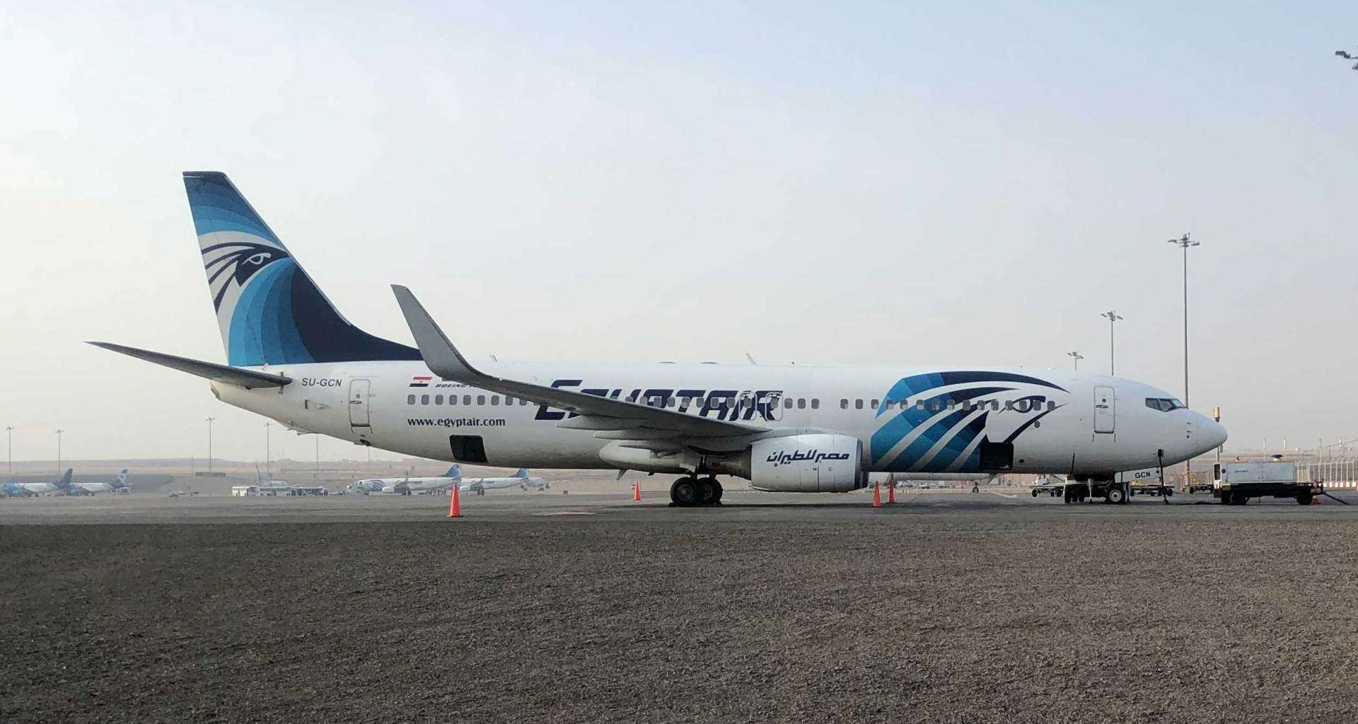 EgyptAir Boeing 737 parked at remote stand.