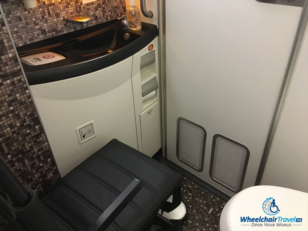 Aisle chair inside the accessible lavatory on an Etihad Airways Boeing 787.