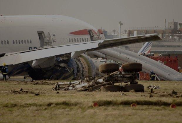 Crashed airplane with emergency evacuation slides deployed.