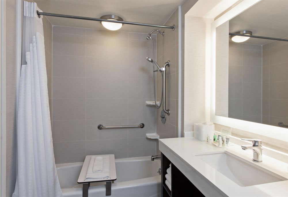 (2) Removable seat in bathtub.