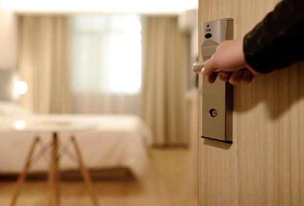 Door opening to a hotel room.