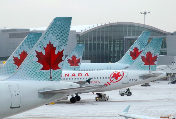 Air Canada airplanes at airport in winter.