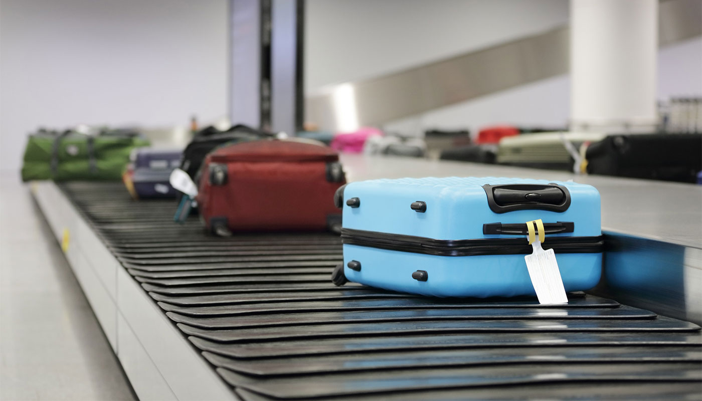 Pieces of luggage on the airport baggage carousel.