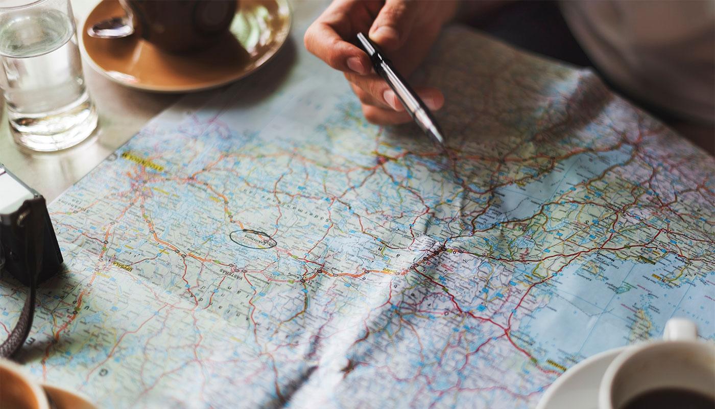 Traveler looking at roadmap.