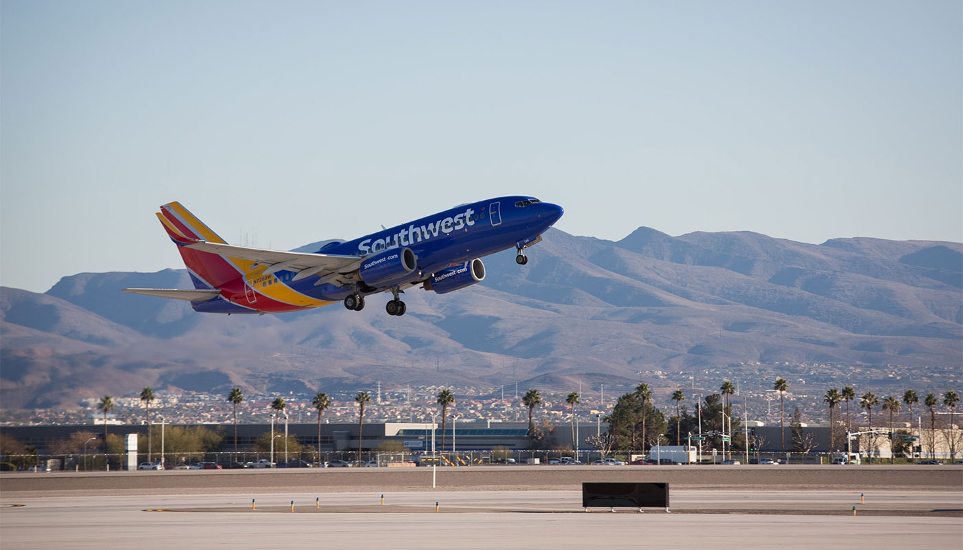 Southwest Airlines airplane taking off from airport.