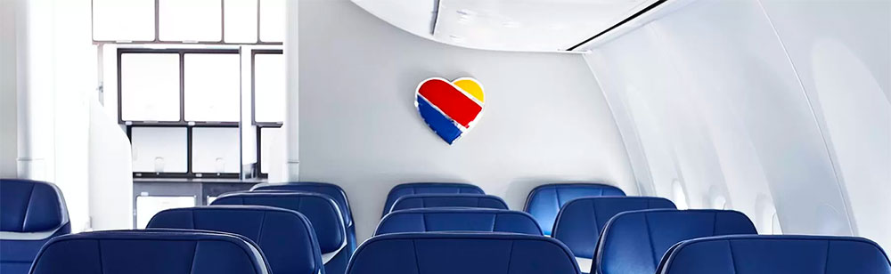 Iconic Southwest heart emblem on aircraft's bulkhead wall.
