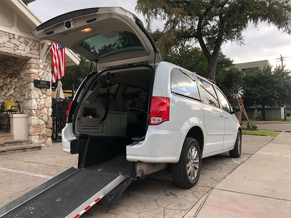 Uber WAV van with wheelchair ramp in Houston, TX.