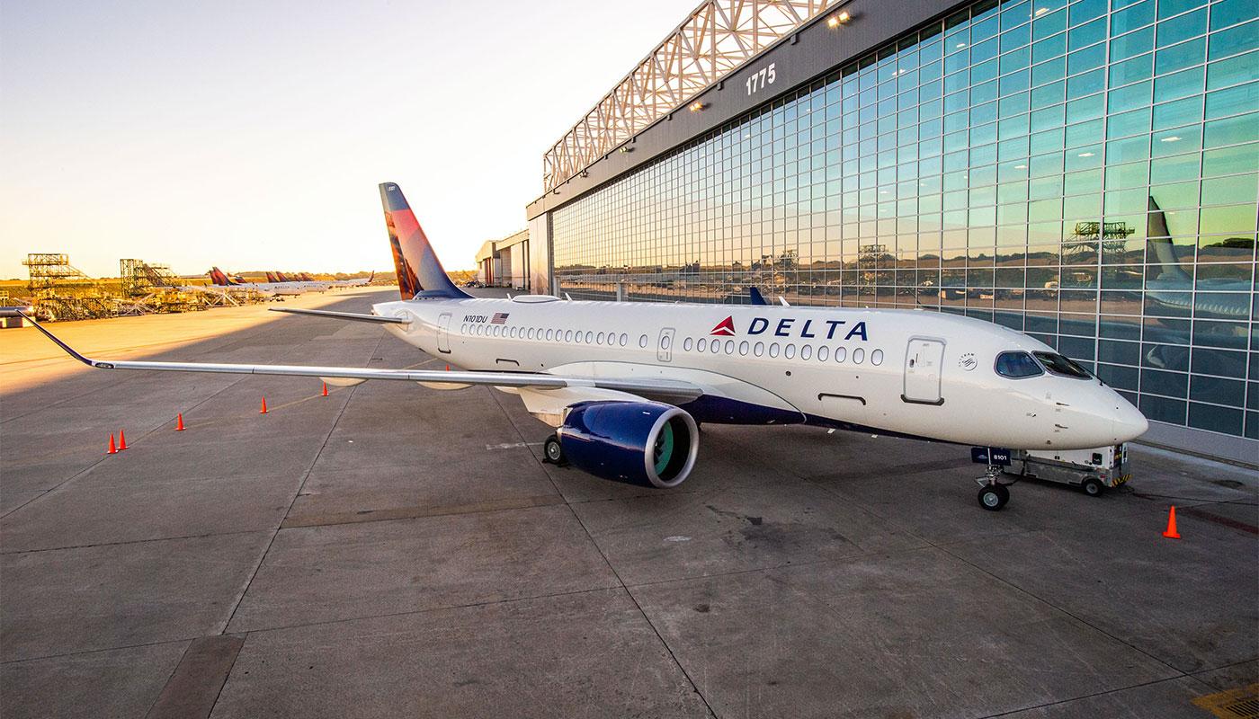 Delta Air Lines Airbus A220 parked at hangar.