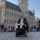 Wheelchair user in Brussels city square.