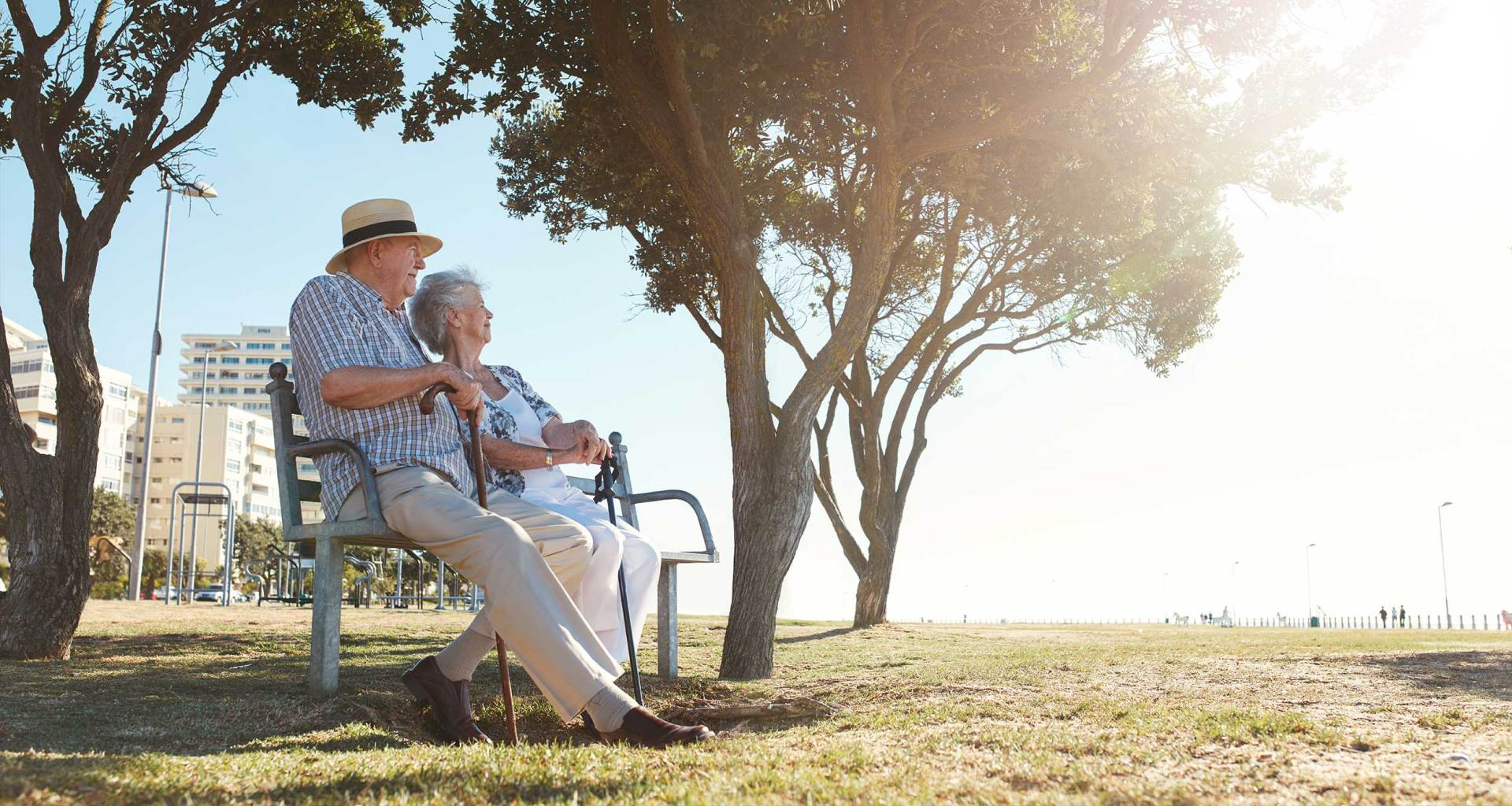 Retired couple relaxing in the park.