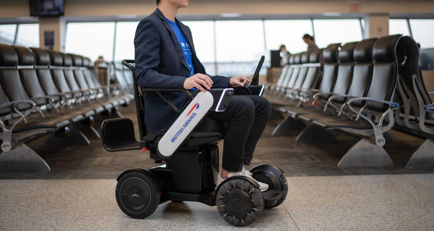Man riding on autonomous BA branded wheelchair.
