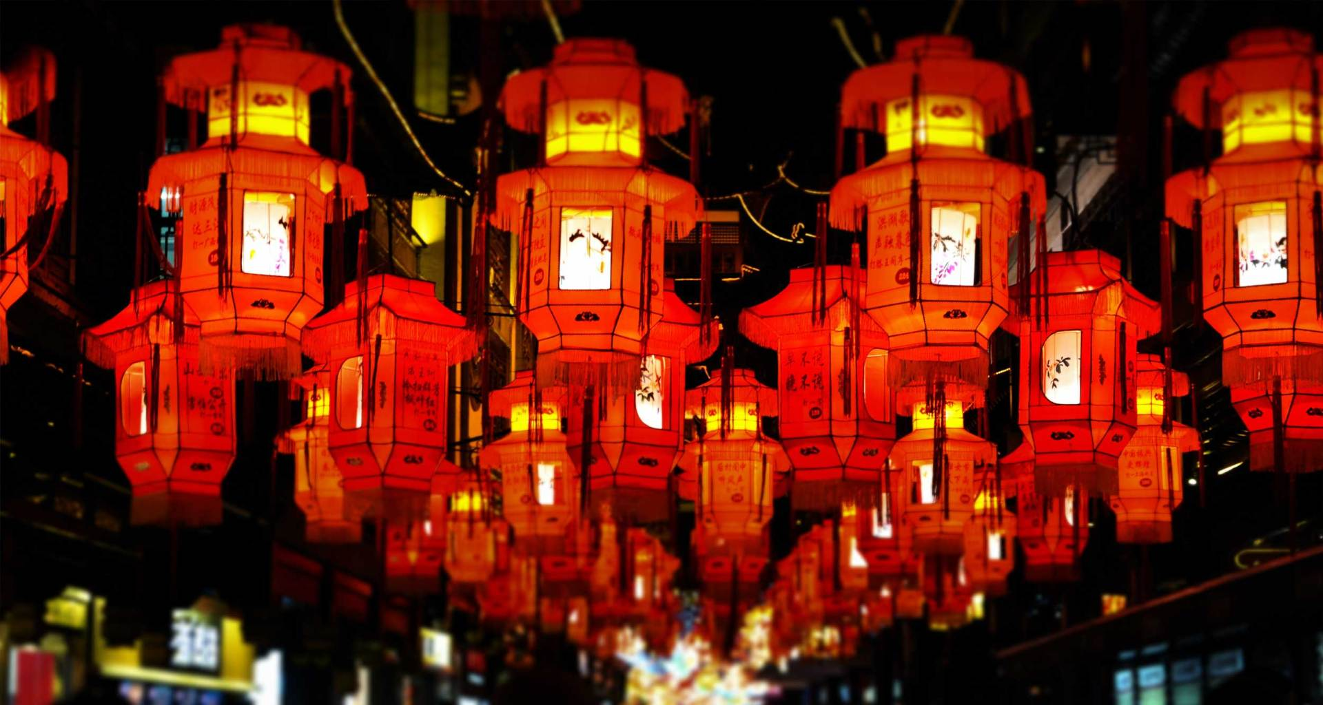 Lanterns hanging over a street in China.
