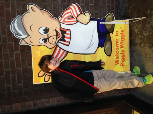Here's A humoring me with a pic next to the Piggly Wiggly pig.