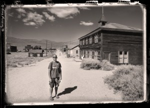 Paul poses by the old schoolhouse in Bodie