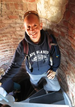 Paul poses on the steps to the tower
