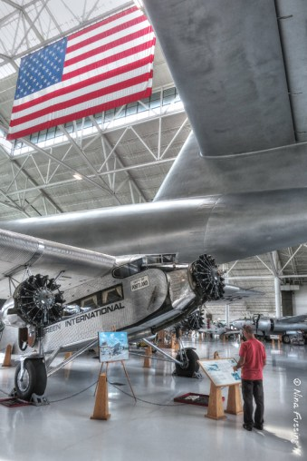 Paul checks out a Ford 5 Tri-Motor underneath the tail of the Spruce Goose