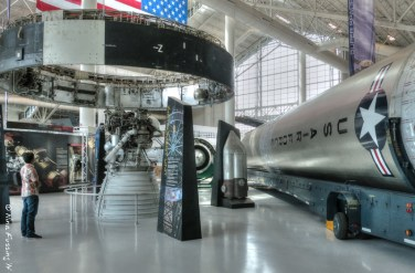 A visitor gawks at a Saturn V Instrument Unit & Rocket