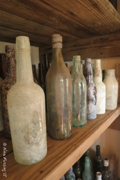 Old whisky bottles colored with age