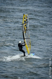 Windsurfers on choppy waters