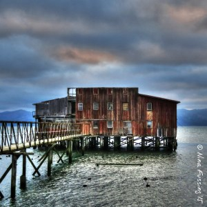 Dramatic sunset over an old cannery building