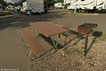"""Typical gravel """"sitting area"""" with picnic table and grill. This is one of the smaller site separations F30."""