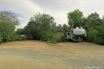 """View near end of """"upper park"""" loop. RV in site #80 with empty site #81 beside it. These were both large sites."""