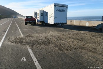 "Back view of ""double wide"" site #5. You can see the rig is off the end of the pavement and partially on the sand."