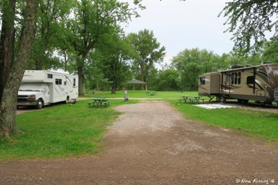 View of full hookup sites by the entrance. Site #2 on right, empty site #3 in middle, site #4 on left.