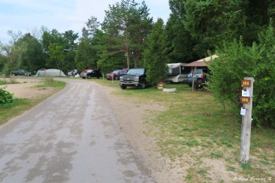 Section E campsites by the water-front. These have lake views out the front. Site 165 on right.
