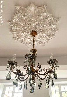 Each room has a lovely chandelier set in plaster medalion