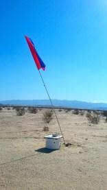 Flags help migrants find water in the desert.