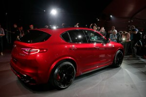 People take pictures of the 2018 Alfa Romeo Stelvio during the Los Angeles Auto Show Wednesday, Nov. 16, 2016, in Los Angeles. (AP Photo/Jae C. Hong)