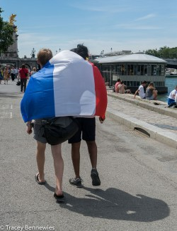 Friends share their flag with other friends.